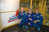 Posádka Sojuzu TMA-8 při předstartovní přípravě (26.03.2006)