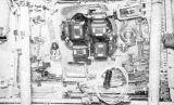 Čtyři kamery Hasselblad 500EL připevněné k oknu velitelské sekce Apolla
