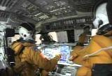 Záběr z videozáznamu, pořízeného posádkou během začátku sestupu atmosférou.