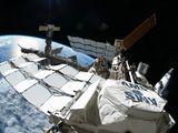 Snímek ISS, který pořídil Garan během výstupu do kosmu v rámci STS-135 (12.07.2011)